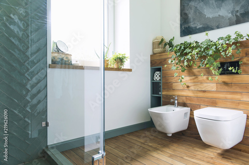 Fotografie, Obraz  Cozy and mediterranean style bathroom in warm colours and natural wood