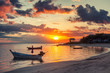 Beautiful bright sunset on the shore of a tropical beach, colorful sky, Thailand