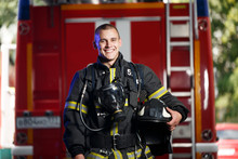 Photo Of Happy Fireman With Ga...