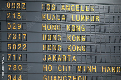 Airport departure board showing flight information Canvas Print