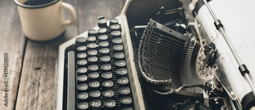 Author Workplace At Home Concept. Typewriter With Paper Sheet