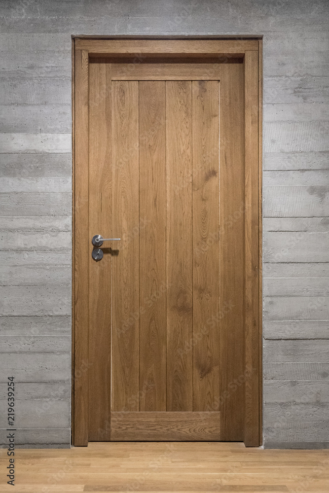 Fototapety, obrazy: Modern quality wooden door in contemporary interior, Solid oak door with stainless steel handle set in concrete wall