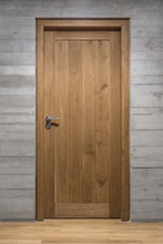 Modern Quality Wooden Door In Contemporary Interior, Solid Oak Door With Stainless Steel Handle Set In Concrete Wall
