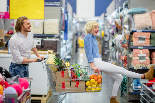 Funny Couple Having Fun While Choosing Food In The