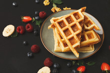 Belgian Waffles With Berries And Fruits At Black
