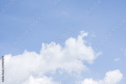 Beautiful white fluffy clouds on a blue sky