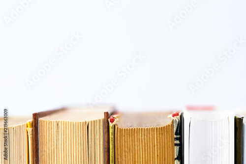 Fotografía  Row of books close up macro shot on white background, space for text