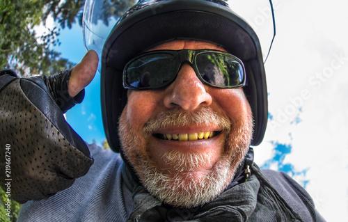 Obraz na płótnie Portrait of a crazy motorcyclist