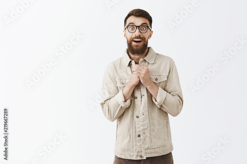 Photo Studio shot of handsome friendly and emotive adult male with long beard and mous