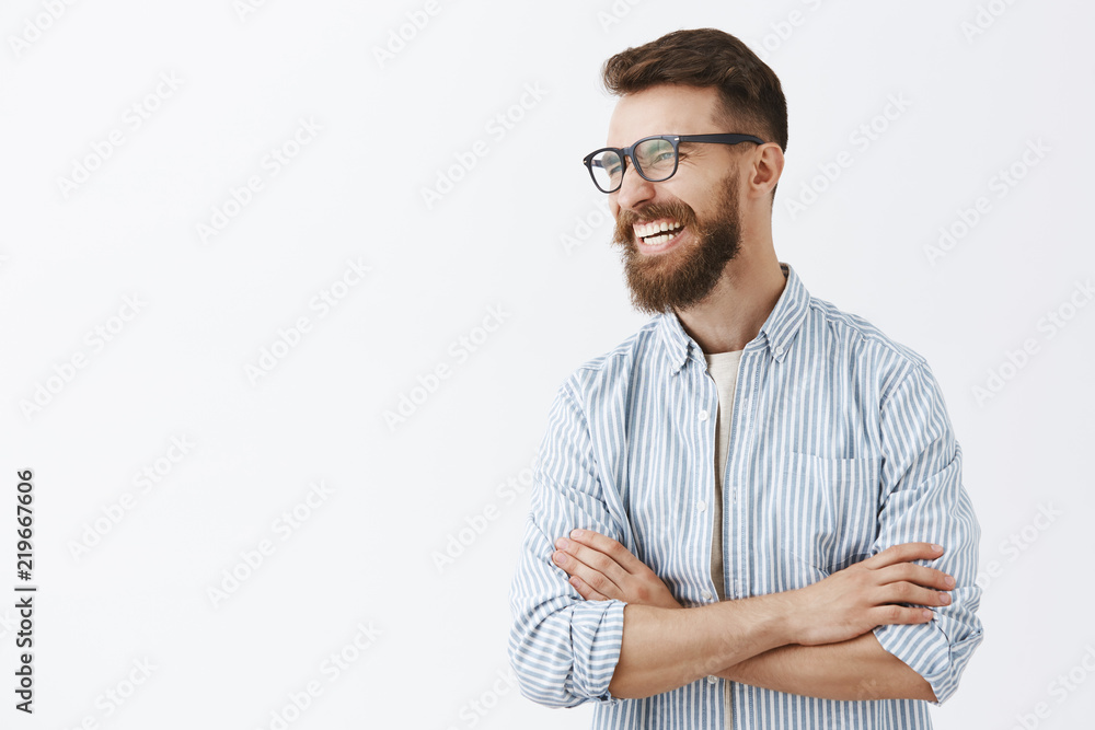 Fototapety, obrazy: Creative happy and funny bearded man with moustache in glasses with black rim turning left laughing out loud enjoying interesting and hilarious conversation holding hands crossed on chest relaxed