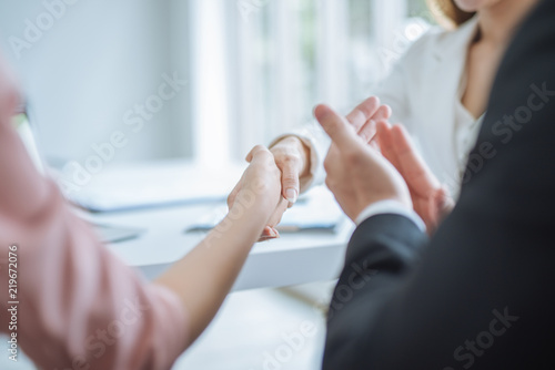 Fototapety, obrazy: handshake of business. business woman shaking hands in office. Business people clapping their hands, congratulation and appreciation for successful dealing and agreement