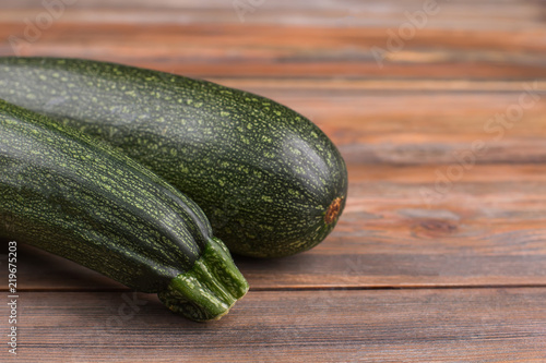 Courgette Black Beauty. Close Up. Brown Wooden Background.