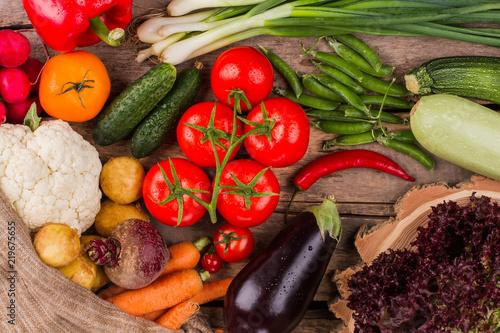 Fotobehang Pile of various vegetables on wood. Raw healthy vegeterian food.