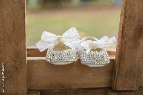 Fototapeta Baby girl shoes - Baptism obraz
