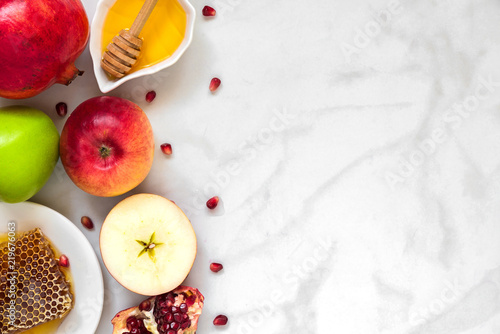Jewish holiday Rosh Hashana background with honey, pomegranate and apples. flat lay. top view