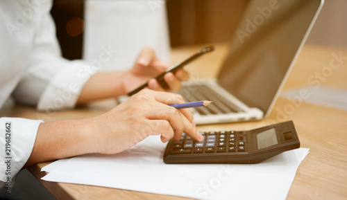 Fotomural  close up on man hand pressing on calculator for calculating cost estimating , se