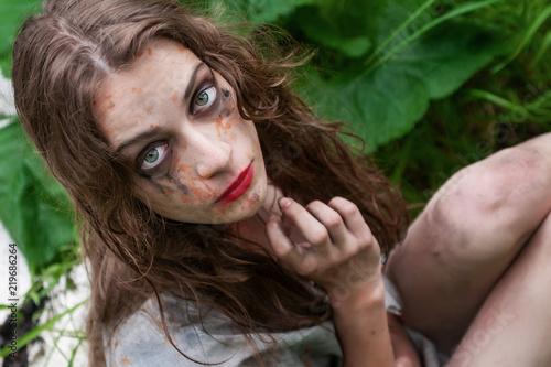 Beautiful young dirty mad and manic looking girl wearing torn clothes and smeare Tapéta, Fotótapéta