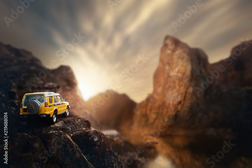 Foto auf Gartenposter Schokobraun Four by four off road car crossing through the country road. Travel and racing concept for four wheel drive off road vehicle .