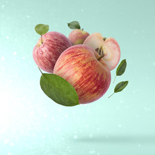 Fresh Apple Flying In Air Over...