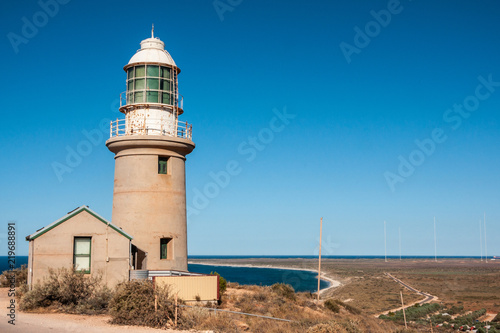 Fotografie, Obraz  Exmouth, Western Australia - November 27, 2009: Vlaming Head Lighthouse overlooking Indian Ocean against deep blue sky