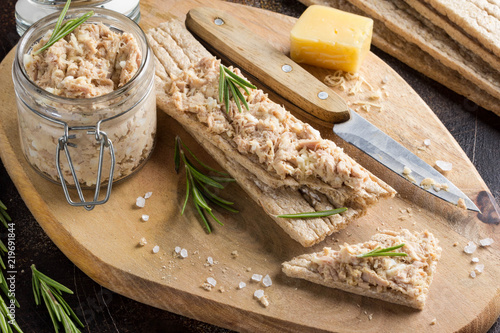 Poster de jardin Entree Tuna pate with egg, cheese in jar and crispy bread. Fish rillette, healthy snack, diet food