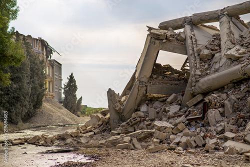 Fotografia Industrial concrete building destructed by strike