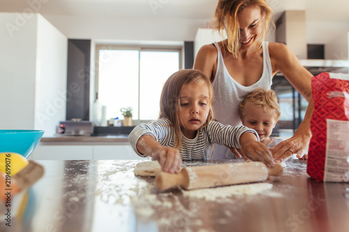 Vászonkép  Family making cookies in kitchen