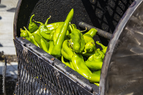 Canvas Print Fresh hatch chilis in an outdoor barrel roaster getting ready to be cooked