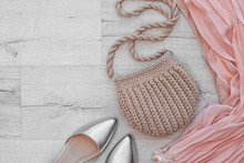 Stylish Set With Knitted Bag And Space For Design On Wooden Background, Flat Lay
