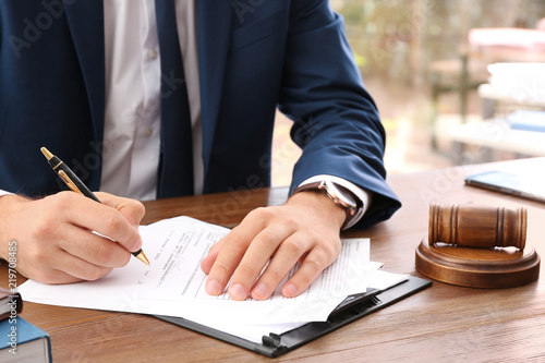 Lawyer working with documents at table, focus on hands Canvas Print