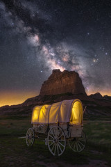 Night sky over old covered wagon along the historical Oregon Trail in Nebraska