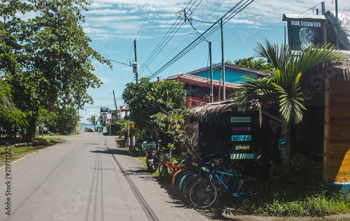 Fototapeta  Street lined with bicycle hire shops and cafes in the popular tourism destinatio
