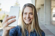 Woman In Her Twenties Taking A Selfie Or Videocalling