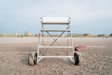 Empty Lifeguard Stand At Wildwood New Jersey Shore Beach With Hotels For Vacation In Background