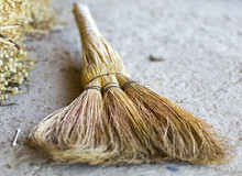 Old Straw Broom Lying On The G...