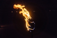 Burning Torch In The Night At Black Background
