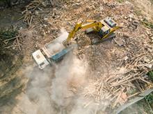 Excavator Working In Debris After House Demolition During Urban Reconstruction. Aerial Photo