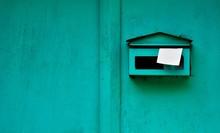 Green Mailbox At Old Wood Door