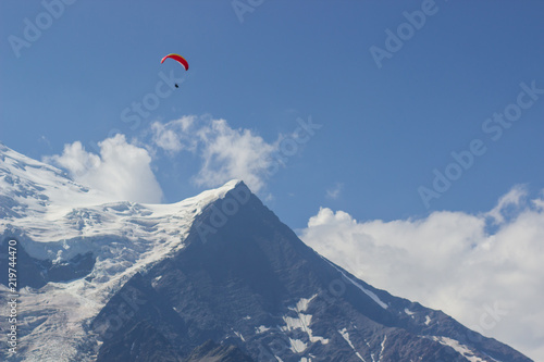 Paragliding over Mont Blanc massif in the French Alps above Chamonix
