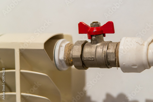 Photo  Water valve with red handle