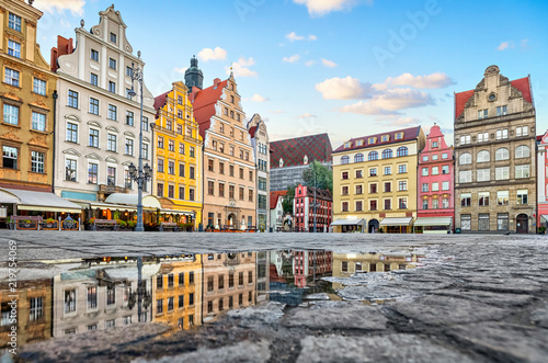 Fototapeta Old colorful buildings reflecting in a puddle on Rynek square in Wroclaw, Poland obraz