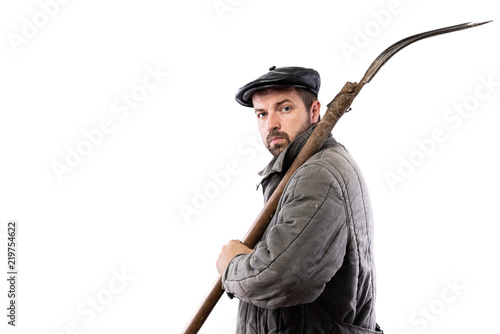 Photo  Peasant man with pitchfork on white background, serious concentrated look