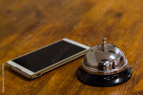 Prime Hotel Service Call Bell And Smartphone On Wooden Reception Home Interior And Landscaping Oversignezvosmurscom