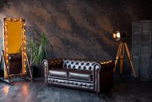 Unusual Loft Interior. Leather Sofa. Room In Brown Color. Luxury Livingroom