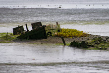 Abandoned Boat Sinking Into Estuary Mud