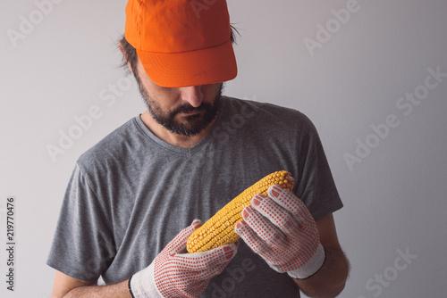 Fotografie, Obraz  Proud authentic farmer posing with corn on the cob