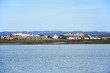View across the River Guadiana towards the white town and its fort and castle, Castro Marim, Algarve, Portugal.