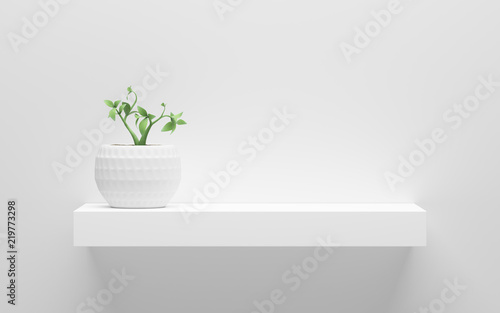 Vászonkép white shelf with green potted plant on wall with light from the top