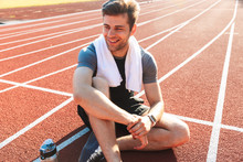 Smiling Sportsman Finished Running At The Stadium