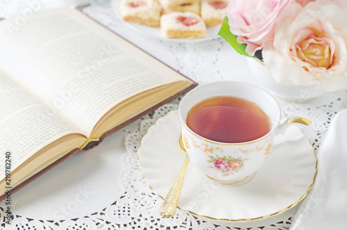 Close up of cup of tea on table with vintage tone